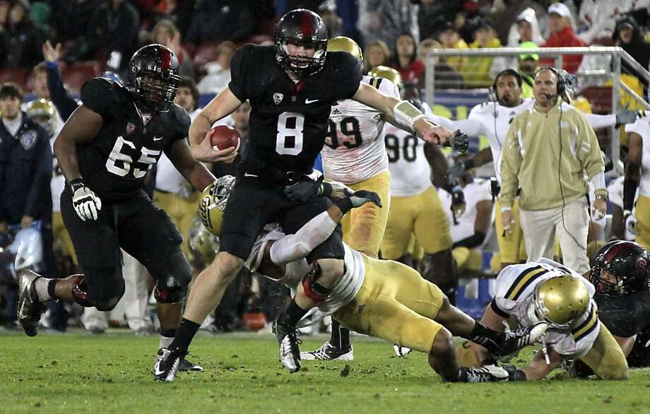Stanford QB Kevin Hogan escapes a tackle Friday Nov. 30, 2012, in the second quarter of their Pack 12 championship game with UCLA in Stanford, Calif. Photo: Lance Iversen, The Chronicle