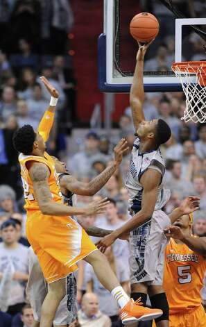 Georgetown forward Mikael Hopkins (3), right, blocks a shot by Tennessee guard D'Montre Edwards (32) during second-half action at the Verizon Center in Washington, D.C., Friday, November 30, 2012. Georgetown defeated Tennessee, 37-36. (Chuck Myers/MCT) Photo: CHUCK MYERS, McClatchy-Tribune News Service / MCT