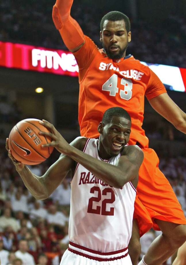 Arkansas' Jacorey Williams (22) pulls in a rebound as Syracuse's James Southerland (43) defends during the second half of an NCAA college basketball game in Fayetteville, Ark., Friday, Nov. 30, 2012. Syracuse defeated Arkansas 91-82. (AP Photo/Gareth Patterson) Photo: Gareth Patterson