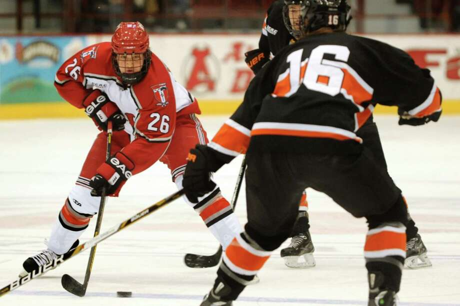 RPI's Mark Miller (26), left, looks for room during their hockey game against Princeton on Friday, Nov. 30, 2012, at Rensselaer Polytechnic Institute in Troy, N.Y. (Cindy Schultz / Times Union) Photo: Cindy Schultz / 00020276A