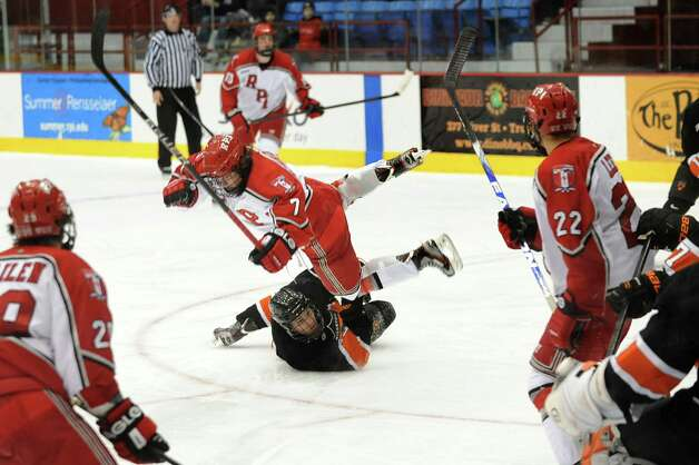 RPI's Zach Schroeder (7), center, gets tripped up by Princeton's Alec Rush (2) during their hockey game on Friday, Nov. 30, 2012, at Rensselaer Polytechnic Institute in Troy, N.Y. (Cindy Schultz / Times Union) Photo: Cindy Schultz / 00020276A