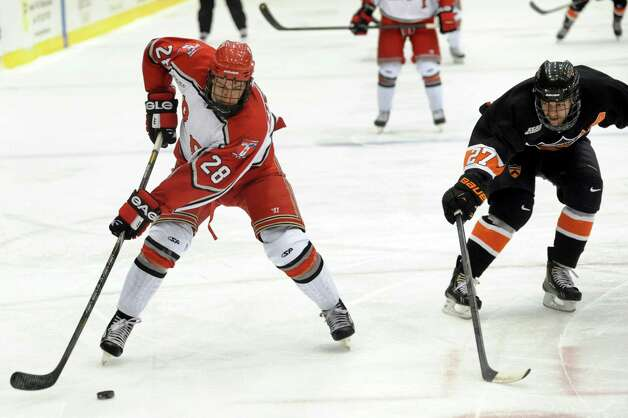 RPI's Matt Tinordi (28), left, looks to shoot as Princeton's Kevin Ross (27) defends during their hockey game on Friday, Nov. 30, 2012, at Rensselaer Polytechnic Institute in Troy, N.Y. (Cindy Schultz / Times Union) Photo: Cindy Schultz / 00020276A