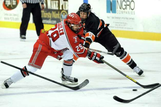 RPI's Nick Bailen (29), left, battles for the puck with Princeton's Jack Berger (9) during their hockey game on Friday, Nov. 30, 2012, at Rensselaer Polytechnic Institute in Troy, N.Y. (Cindy Schultz / Times Union) Photo: Cindy Schultz / 00020276A