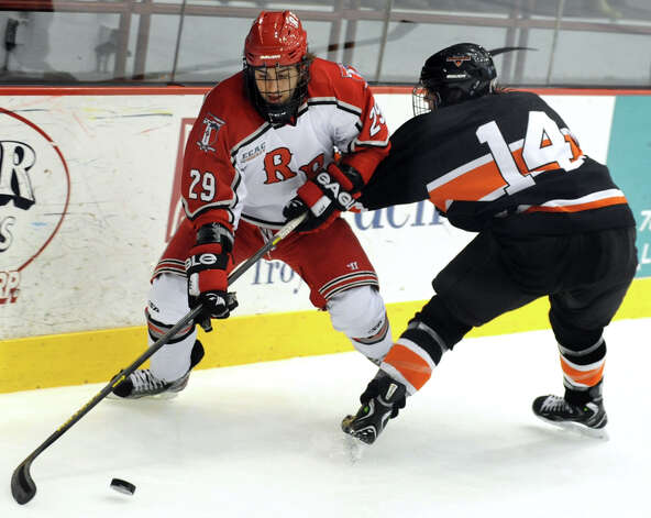 RPI's Nick Bailen (29), left, works the boards as Princeton's Andrew Ammon (14) defends during their hockey game on Friday, Nov. 30, 2012, at Rensselaer Polytechnic Institute in Troy, N.Y. (Cindy Schultz / Times Union) Photo: Cindy Schultz / 00020276A