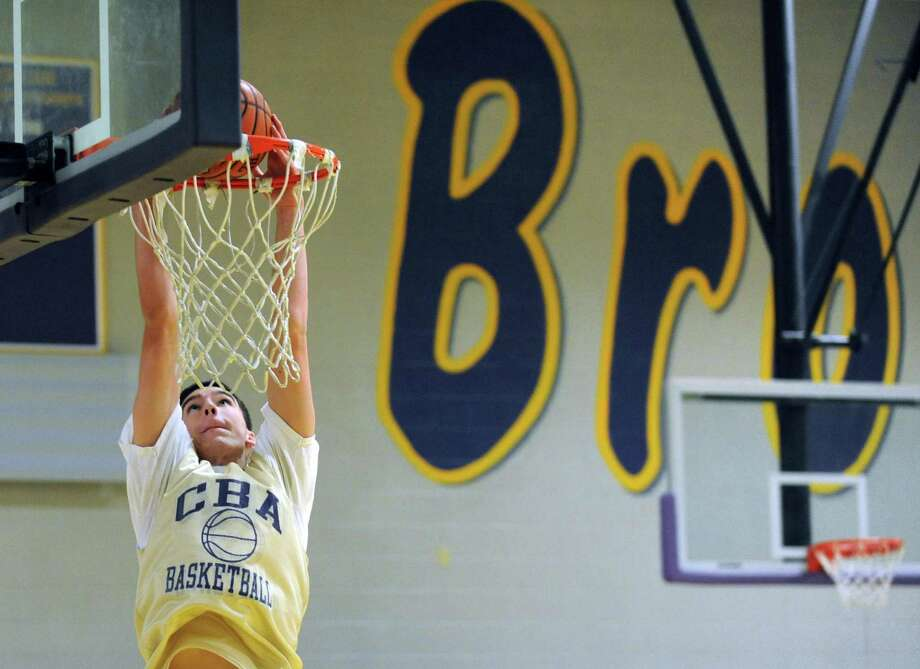CBA basketball power forward Greg Stire goes in for a basket during their practice in Colonie, NY Thursday Nov. 29, 2012. (Michael P. Farrell/Times Union) Photo: Michael P. Farrell