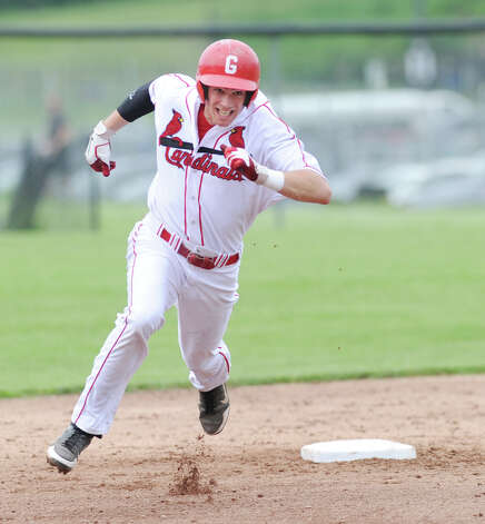 Taylor Olmstead of Greenwich on his way to a triple in which he drove in teammate Dylan Callahan during the bottom of the first inning  in the boys high school Class LL baseball playoff game between Greenwich High School and Conard High School at Greenwich, Wednesday, May 30, 2012. Photo: Bob Luckey / Greenwich Time