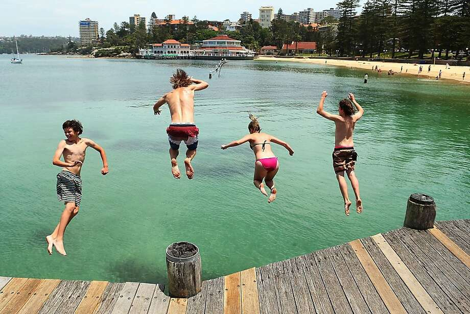 Manly fun for juveniles: Kids leap off Manly Wharf on a warm summer day in Sydney. Photo: Brendon Thorne, Getty Images