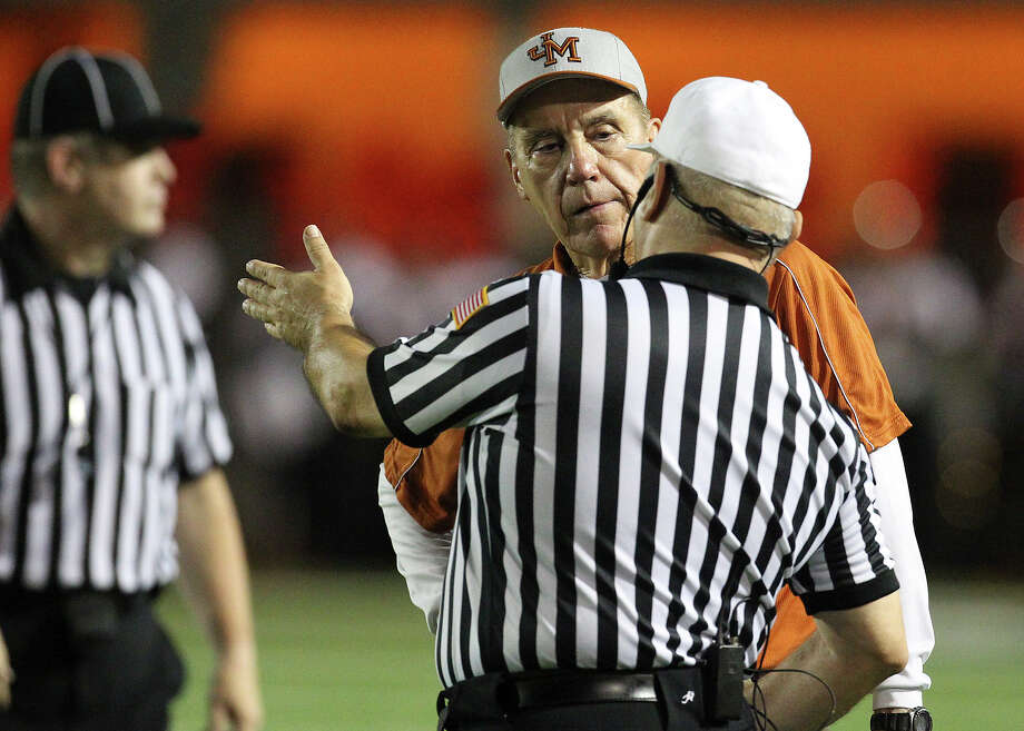 Madison head couch Jim Streety talks with a game official after a scuffle nearly breaks out against Mission Sharyland near the end of the first half in the Class 5A Div. I playoff game in Corpus Christi on Friday, Nov. 30, 2012. Photo: Kin Man Hui, Express-News / © 2012 San Antonio Express-News