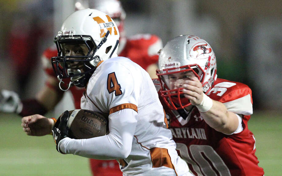 Madison's Byron Daniels (04) runs from Mission Sharyland's Bradley Klein (30) in the second half in the Class 5A Div. I playoff game in Corpus Christi on Friday, Nov. 30, 2012. Photo: Kin Man Hui, Express-News / © 2012 San Antonio Express-News