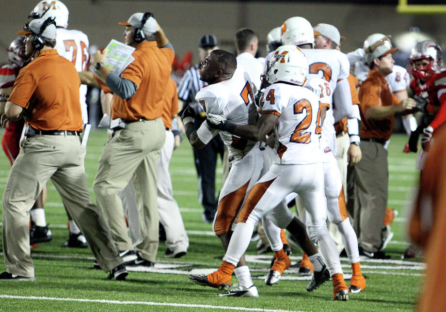 Madison's Marquis Warford (07) reacts after a scuffle breaks out against Mission Sharyland players near the end of the first half in the Class 5A Div. I playoff game in Corpus Christi on Friday, Nov. 30, 2012. Photo: Kin Man Hui, Express-News / © 2012 San Antonio Express-News