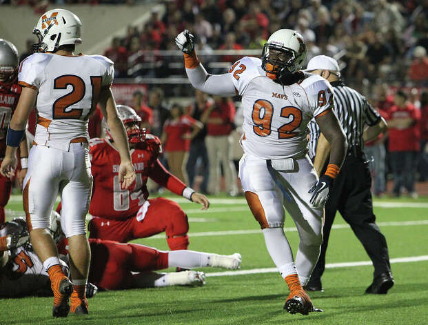 Madison's Vincent Taylor (92) reacts after sacking the Mission Sharyland quarterback for a saftey in the first half in the Class 5A Div. I playoff game in Corpus Christi on Friday, Nov. 30, 2012. Photo: Kin Man Hui, Express-News / © 2012 San Antonio Express-News