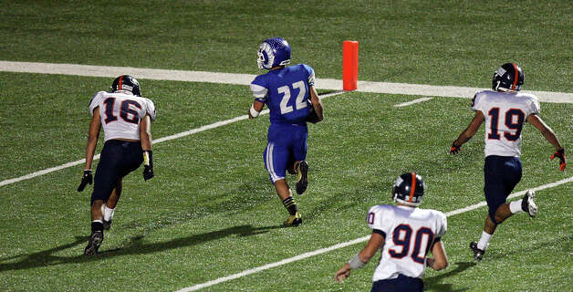 Del Rio's Gudelio Garza heads to the end zone for a touchdown around Brandeis' Leoness Aguilar during second half action Friday Nov. 30, 2012 at Eagle Pass ISD Stadium in Eagle Pass, Tx. Brandeis won 63-7. Photo: Edward A. Ornelas, Express-News / © 2012 San Antonio Express-News
