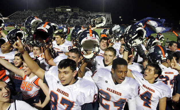 Members of the Brandeis football team and others celebrates their 63-7 win over Del Rio Friday Nov. 30, 2012 at Eagle Pass ISD Stadium in Eagle Pass, Tx. Photo: Edward A. Ornelas, Express-News / © 2012 San Antonio Express-News