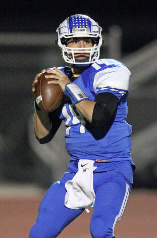 Del Rio's Jorge Fernandez looks to pass against Brandeis during first half action Friday Nov. 30, 2012 at Eagle Pass ISD Stadium in Eagle Pass, Tx. Photo: Edward A. Ornelas, Express-News / © 2012 San Antonio Express-News