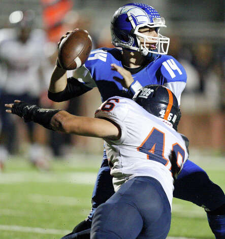 Del Rio's Jorge Fernandez looks to pass under pressure from Brandeis' Christian Olguin during first half action Friday Nov. 30, 2012 at Eagle Pass ISD Stadium in Eagle Pass, Tx. Photo: Edward A. Ornelas, Express-News / © 2012 San Antonio Express-News