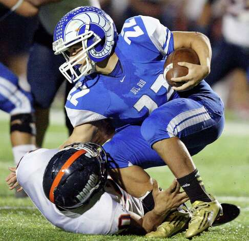 Del Rio's Gudelio Garza is tackled by Brandeis' Corey Hayes during first half action Friday Nov. 30, 2012 at Eagle Pass ISD Stadium in Eagle Pass, Tx. Photo: Edward A. Ornelas, Express-News / © 2012 San Antonio Express-News
