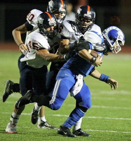 Del Rio's Jorge Fernandez is tackled by Brandeis' Chase Guillory (left) and Brandeis' Alec Sifuentes during first half action Friday Nov. 30, 2012 at Eagle Pass ISD Stadium in Eagle Pass, Tx. Photo: Edward A. Ornelas, Express-News / © 2012 San Antonio Express-News
