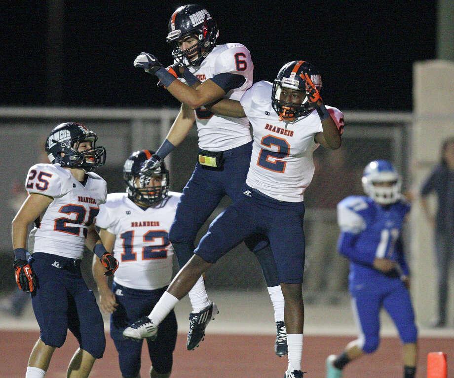 Brandeis' Trevor Hernandez (from left) watches as teammates Brandeis' Alec Sifuentes and Brandeis' Kadarius Lee celebrate after Lee scored a touchdown on a punt return against Del Rio during first half action Friday Nov. 30, 2012 at Eagle Pass ISD Stadium in Eagle Pass, Tx Photo: Edward A. Ornelas, Express-News / © 2012 San Antonio Express-News