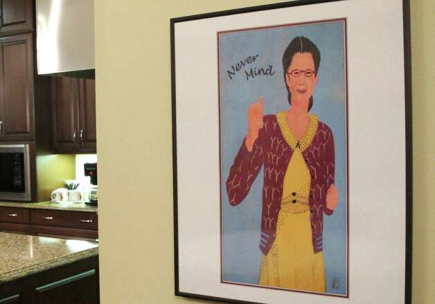 A framed image of comedian Gilda Radner hangs on the wall inside the cancer support group Gilda's Club Madison on Wednesday, Nov. 27, 2012, in Middleton, Wis. The Madison-area chapter of the national group is the latest to change its name to the Cancer Support Community, a move its director said was necessary because young people don't know who Radner was.  (AP Photo/Scott Bauer) Photo: Scott Bauer