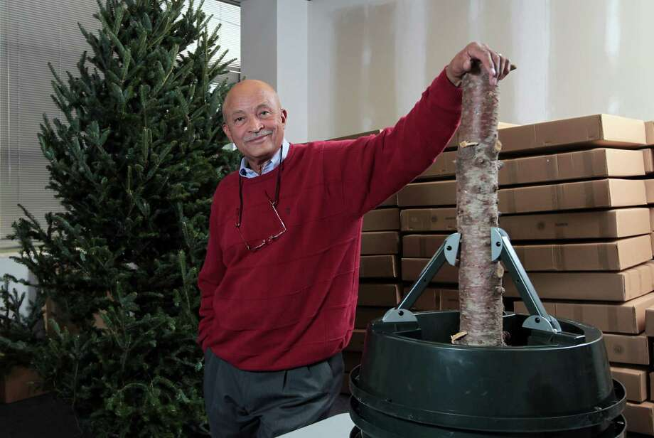 Harold Odom says finding a smart way to brace a tree was crucial to his creation, the Standtastic Adjustable Christmas Tree Stand. Photo: James Nielsen, Staff / © Houston Chronicle 2012