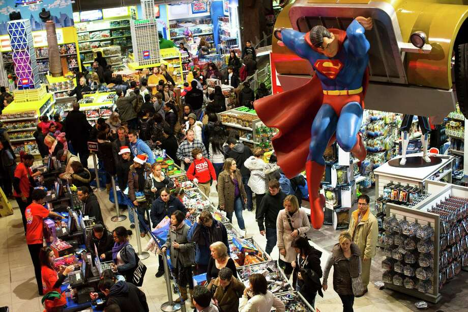 Shoppers wait to check out at New York's Times Square Toys R Us store on Thanksgiving night. Despite what surveys indicate, retailers say their layaway programs are bringing increased sales. Photo: John Minchillo, FRE / FR170537 AP