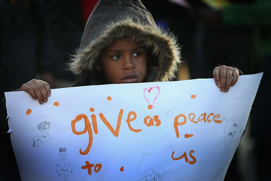 CHICAGO, IL - NOVEMBER 30:  Six-year-old Burnell Johnson marches in the Washington Park neighborhood during a peace vigil on November 30, 2012 in Chicago, Illinois. About 75 children, teachers, and parents were joined by area residents and religious leaders as they marched to draw attention to the violence that plagues their Southside neighborhood. Through the end of October 436 people were murdered in Chicago, surpassing the 435 murders for all of 2011. Photo: Scott Olson, Getty Images
