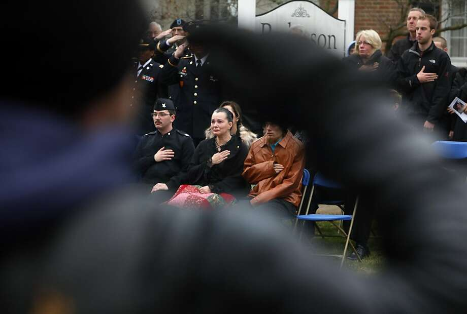 Gloria Shanafelt, the mother of Army Specialist Zachary Shanafelt, places her hand on her heart during her son's funeral outside Pederson Funeral Home in Rockford, Mich.  on Friday, Nov. 30, 2012.  Shanafelt died from injuries he sustained while serving in Afghanistan. He was hurt in an accident last year and died Nov. 21 at Walter Reed Hospital in Washington. Survivors include wife Marina, 13-month-old son Daniel, parents Patrick and Gloria Shanafelt, and brothers Christopher and Silas Shanafelt. Photo: Emily Zoladz, Associated Press