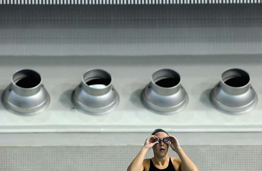 Kasey Carlson adjusts her goggles before the Women's 100 Breaststroke during day two of the 2012 AT&T Winter National Championships on November 30, 2012 at the Lee and Joe Jamail Texas Swimming Center in Austin, Texas. Photo: Ronald Martinez, Getty Images