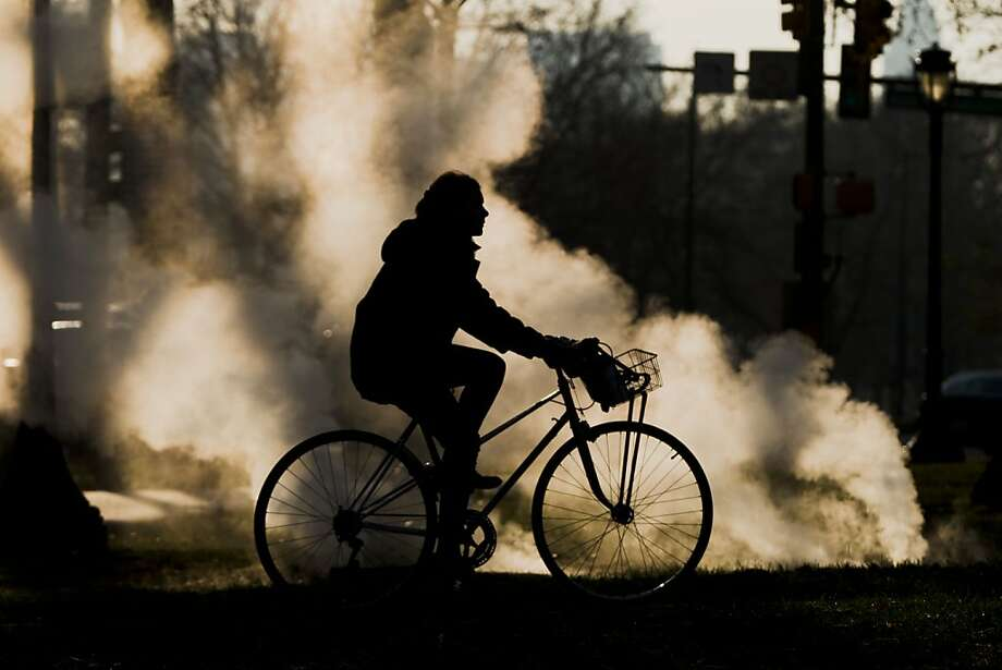 A cyclist passes by steam vented from a grate near the Philadelphia Museum of Art on a cold morning, Friday, Nov. 30, 2012, in Philadelphia. Photo: Matt Rourke, Associated Press
