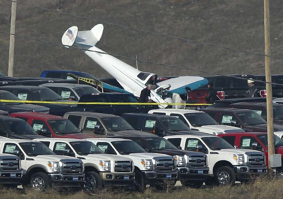 FAA investigators work the scene of a plane crash in Blair, Neb., Friday, Nov. 30, 2012. The plane was piloted by 92-year-old Robert Harrick of Nickerson, who died when his single-engine Ercoupe 415-C plane went down in a car lot on the south side of Blair around 5:15 p.m. on Thursday. Photo: Nati Harnik, Associated Press