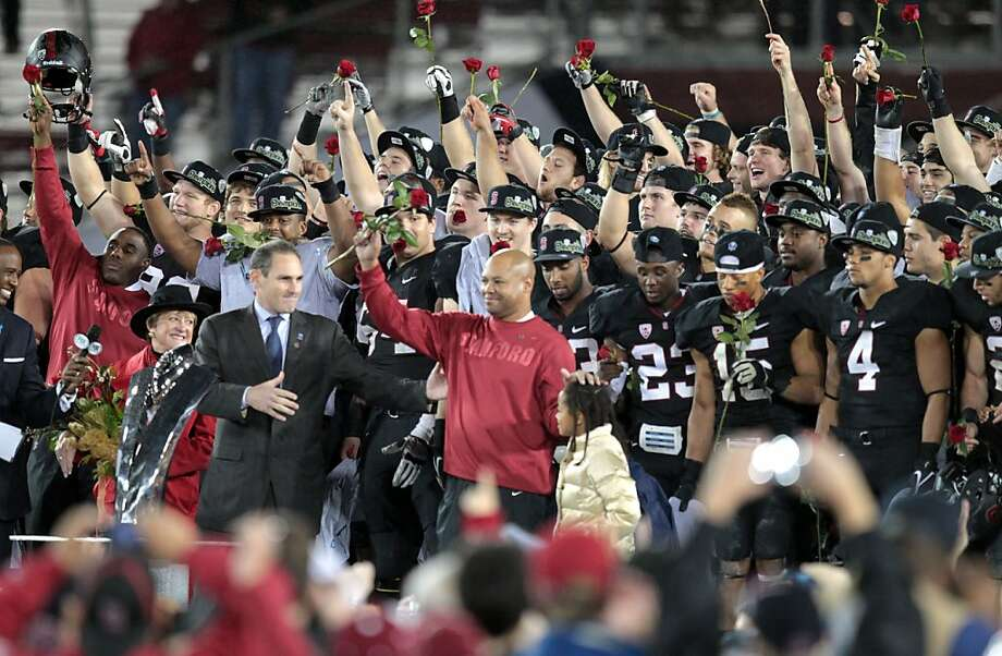 Stanford head coach Davis Shaw stand with his team and daughter Keegan Friday Nov. 30, 2012, after they defeated UCLA for the PAC 12 championship at Stanford 27-24. Photo: Lance Iversen, The Chronicle