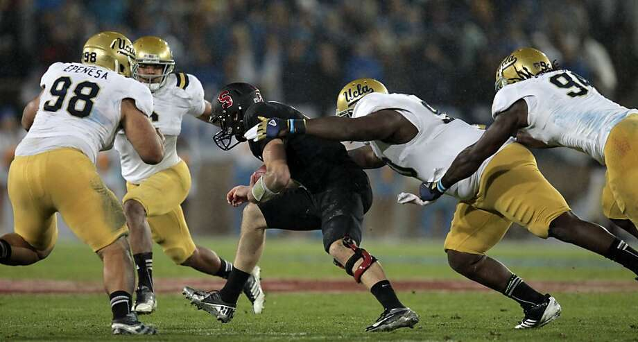 Stanford QB Kevin Hogan escapes the first wave of tacklers only to be caught after a six yard gain Friday Nov. 30, 2012, in the second quarter of their Pack 12 championship game with UCLA in Stanford, Calif. Photo: Lance Iversen, The Chronicle