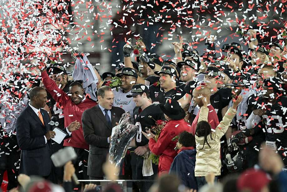 Stanford QB Kevin Hogan center was awarded the MVP trophy Friday Nov. 30, 2012, after the Cardinal defeated UCLA for the Pack 12 championship 27-24. Photo: Lance Iversen, The Chronicle