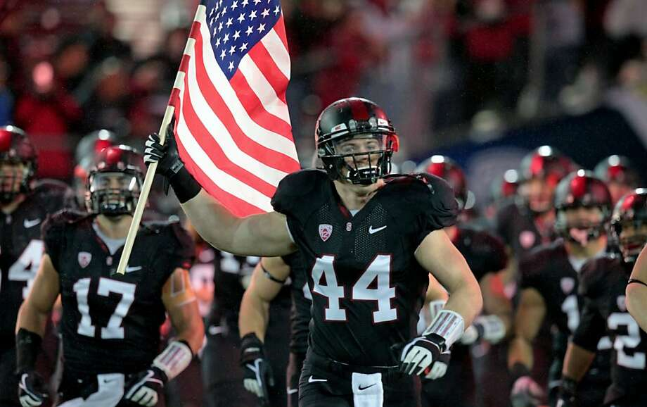 Stanford John Flacco carries the American flag as he leads his teammates onto the field Friday Nov. 30, 2012, for their Pack 12 championship game with UCLA in Stanford, Calif. Photo: Lance Iversen, The Chronicle