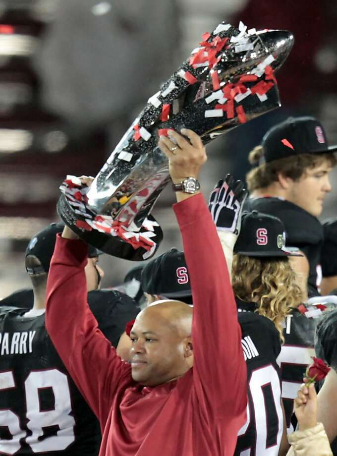 Stanford head coach David Shaw holds up the PAC-12 Championship trophy Friday Nov. 30, 2012, after the Cardinal defeated the UCLA 27-24. Photo: Lance Iversen, The Chronicle