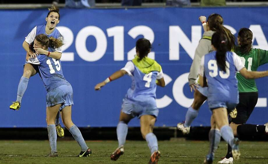 North Carolina's Kealia Ohai, above left, celebrates her goal in overtime with teammate Katie Bowen (15) after beating Stanford in an NCAA women college soccer semifinal game Friday, Nov. 30, 2012, in San Diego. North Carolina won, 1-0. (AP Photo/Gregory Bull) Photo: Gregory Bull, Associated Press