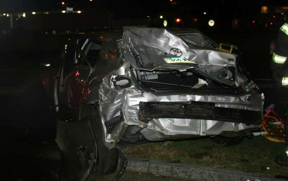 The tangled wreck of a car that collided early Saturday with a tractor-trailer truck in the Fairfield rest area of northbound Interstate 95.  Fairfield CT 12/1/12 Photo: Fairfield Fire Department / Fairfield Citizen contributed