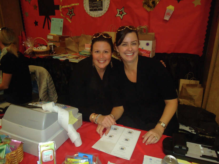 Christina Cush and Tracy Simms, co-chairmen of the Royle Book Fair, take a break from ringing up sales. The fair combined the interest in great books and movies. Photo: Contributed