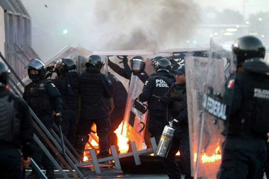 Police officers clash with rioters outside of the Congress building before the inauguration ceremony of incoming Mexican President Enrique Pena Nieto on December 1, 2012, in Mexico City. Pena Nieto was sworn in as president of Mexico on Saturday following protests by leftist lawmakers inside the congress and clashes between demonstrators and police outside AFP PHOTO/Pedro PardoPedro PARDO/AFP/Getty Images Photo: PEDRO PARDO, AFP/Getty Images / AFP
