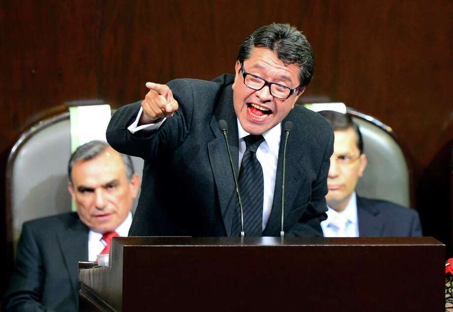 Mexican congressman Ricardo Monreal of the Movimiento Ciudadano Party delivers a speak protesting against the return of the Institutional Revolutionary Party (PRI) to power, during a session at the Congress held before the arrival of Enrique Pena Nieto for his inauguration in Mexico City, on December 1, 2012. Enrique Pena Nieto was sworn in as president of Mexico on Saturday following protests by leftist lawmakers inside the congress and clashes between demonstrators and police outside.  AFP PHOTO/ALFREDO ESTRELLAALFREDO ESTRELLA/AFP/Getty Images Photo: ALFREDO ESTRELLA, AFP/Getty Images / ALFREDO ESTRELLA