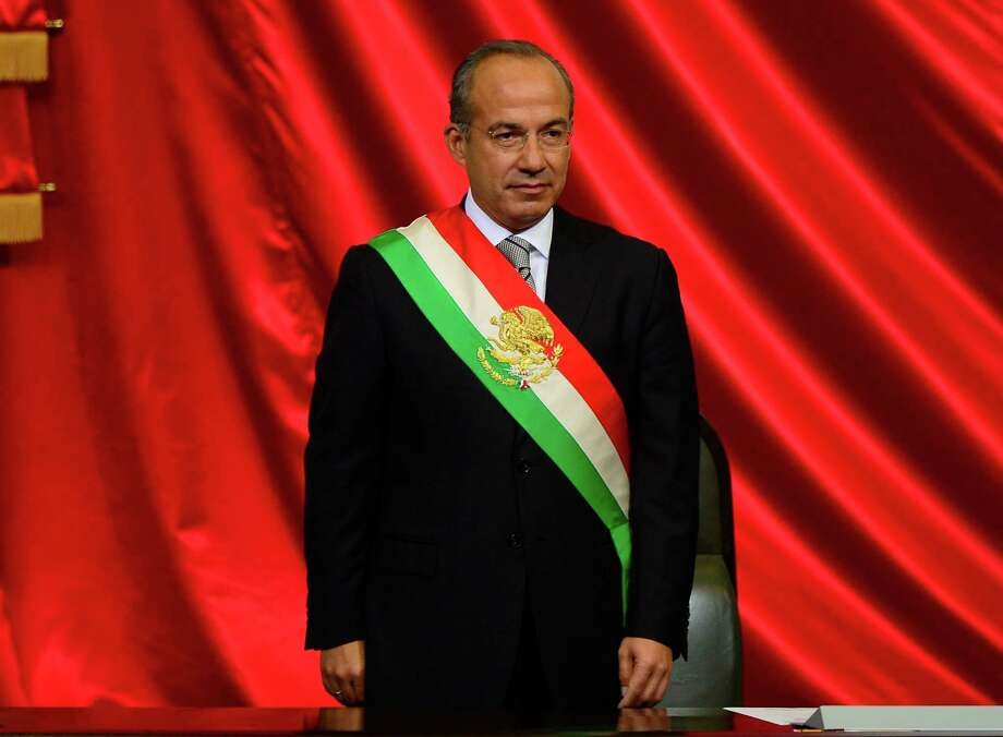 Mexican outgoing President Felipe Calderon waits for the arrival of his successor Enrique Pena Nieto during the inauguration ceremony at the Congress in Mexico City, on December 1, 2012. Enrique Pena Nieto was sworn in as president of Mexico on Saturday following protests by leftist lawmakers inside the congress and clashes between demonstrators and police outside.  AFP PHOTO/ALFREDO ESTRELLAALFREDO ESTRELLA/AFP/Getty Images Photo: ALFREDO ESTRELLA, AFP/Getty Images / AFP