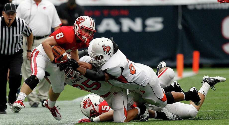 Katy's Kyle Porter is knocked out of bounds in the second quarter. Photo: Bob Levey, Houston Chronicle / ©2012 Bob Levey