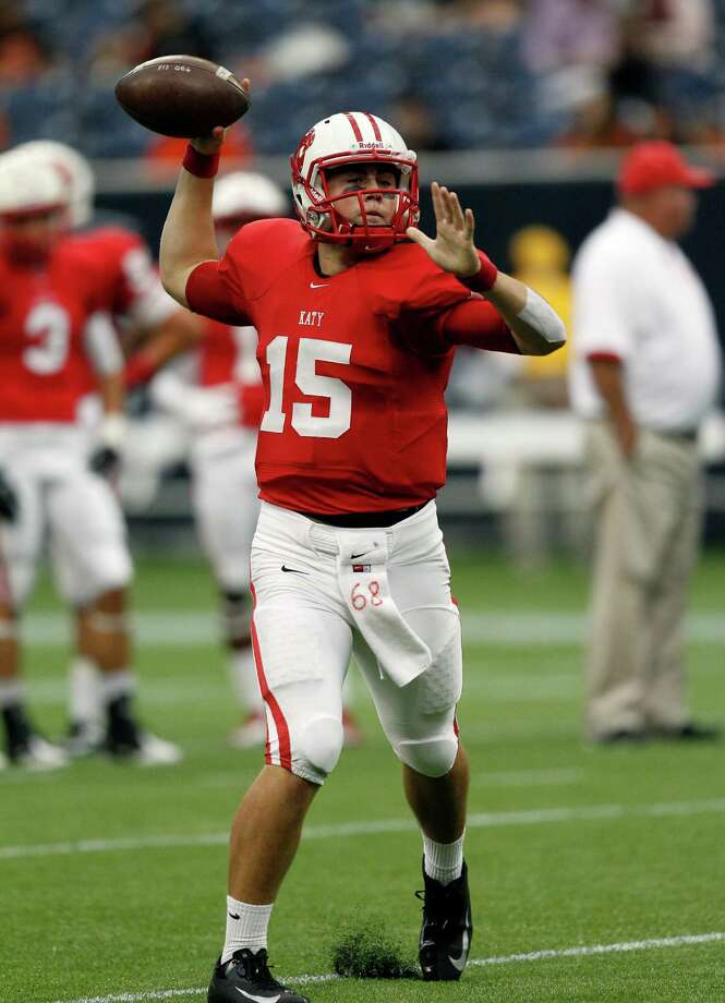 Katy quarterback warms up before taking the field against La Porte. Photo: Bob Levey, Houston Chronicle / ©2012 Bob Levey