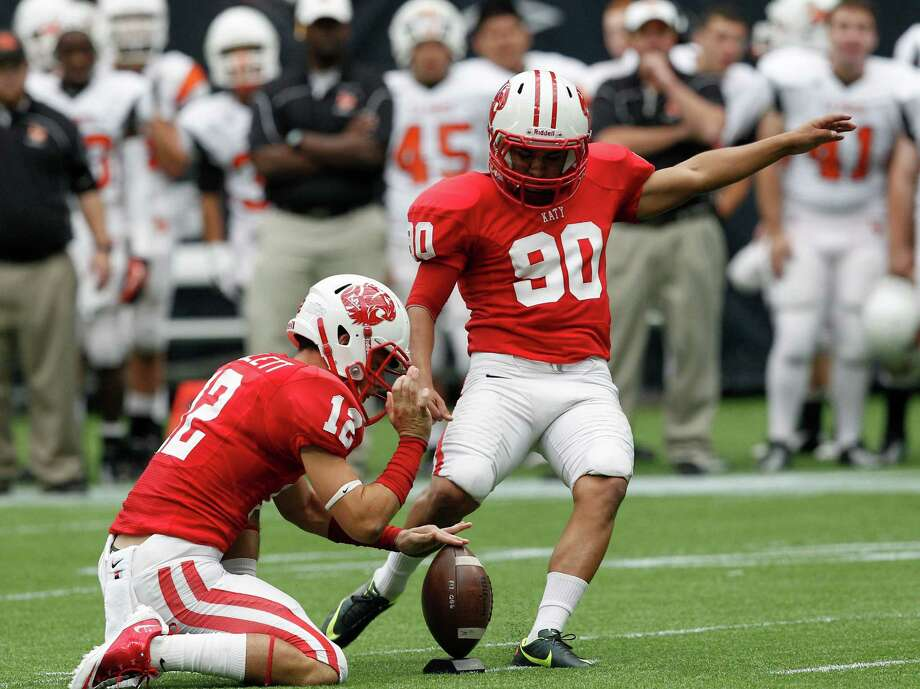 Katy kicker Manny Mendoza connects on a field goal in the first quarter. Photo: Bob Levey, Houston Chronicle / ©2012 Bob Levey