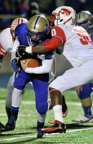 Newtown quarterback Andrew Tarantino is tackled by Norwich Free Academy's Tuzar Skipper during their Class LL state quarterfinal game at Newtown High School on Wednesday, Nov. 28, 2012. N.F.A. won, 63-21. Photo: Jason Rearick / The News-Times