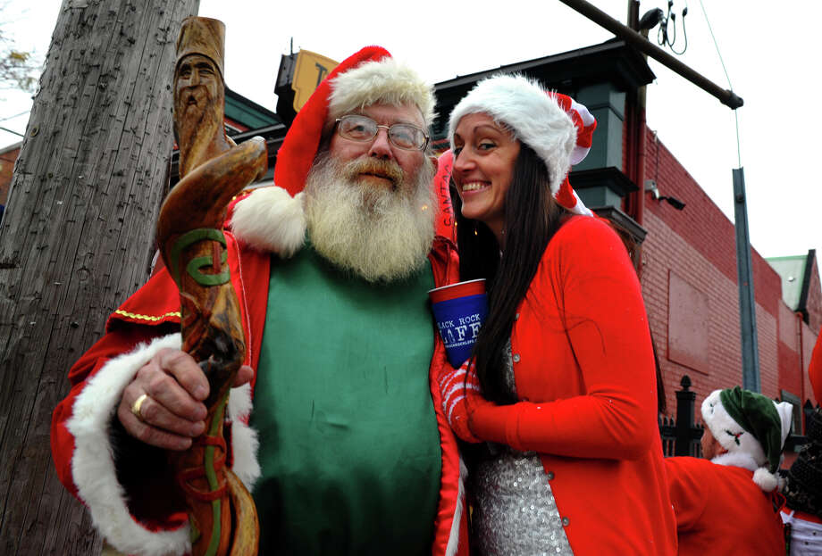 Cristy Gonzales and Ray Corby attend Bridgeport Wingding and Black Rock Life's 1st Annual Rock'n the Ave SantaCon 2012 pubcrawl at The Creek in Bridgeport, Conn. on Saturday December 1, 2012. Participants dressed up as Santa or other holiday characters and made their way to six other bars along Fairfield Avenue taking part in the event. Photo: Christian Abraham / Connecticut Post