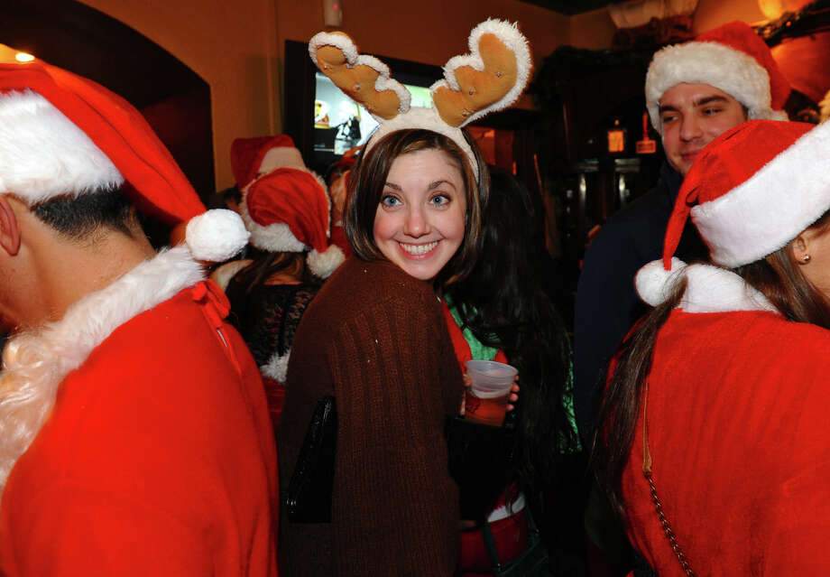 Sara Sweeney takes part in Bridgeport Wingding and Black Rock Life's 1st Annual Rock'n the Ave SantaCon 2012 pubcrawl at The Creek in Bridgeport, Conn. on Saturday December 1, 2012. Participants dressed up as Santa or other holiday characters and made their way to six other bars along Fairfield Avenue taking part in the event. Photo: Christian Abraham / Connecticut Post
