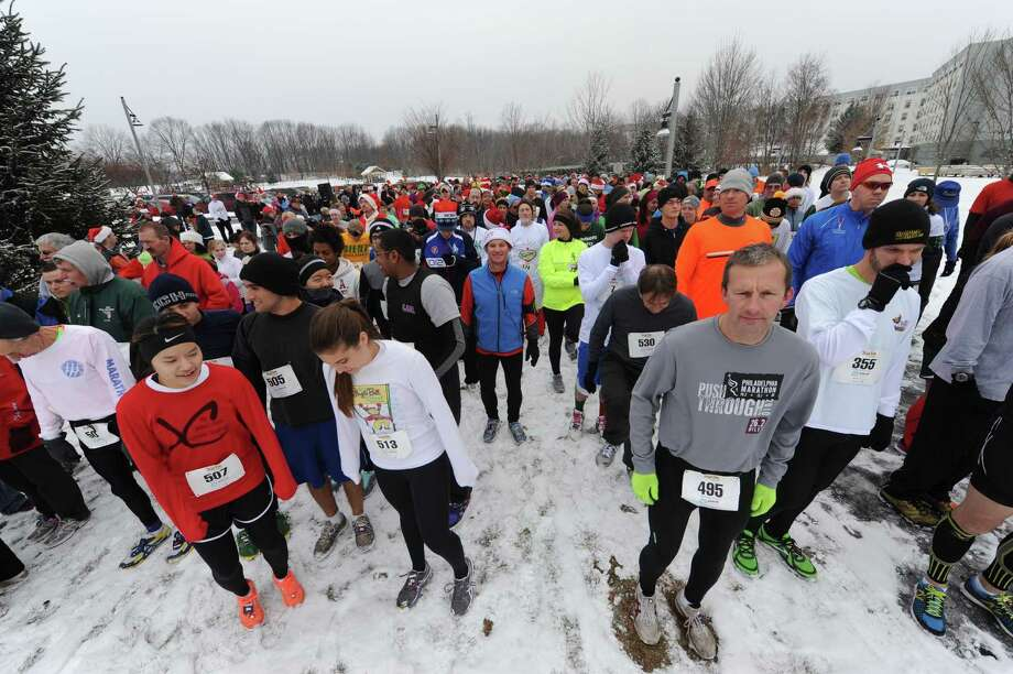 Runners get set at the starting line as they take part in the 2012 Jingle Bell Run/Walk to benefit the Arthritis Foundation of Northeastern New York at the Crossings in a Colonie, NY Thursday Dec. 1, 2012. (Michael P. Farrell/Times Union) Photo: Michael P. Farrell