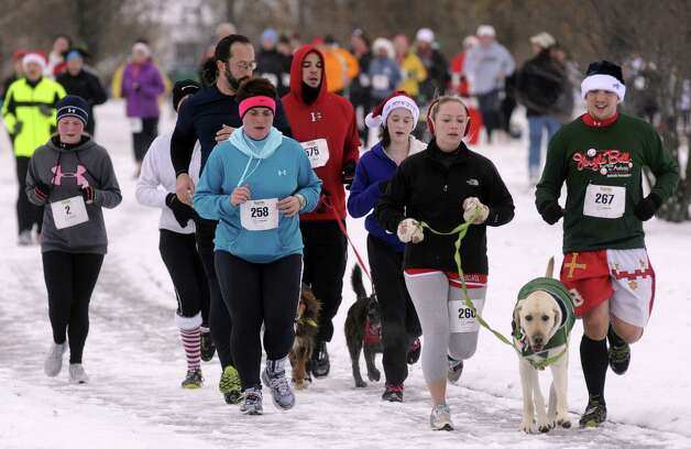 Runners and dogs take part in the 2012 Jingle Bell Run/Walk to benefit the Arthritis Foundation of Northeastern New York at the Crossings in a Colonie, NY Thursday Dec. 1, 2012. (Michael P. Farrell/Times Union) Photo: Michael P. Farrell