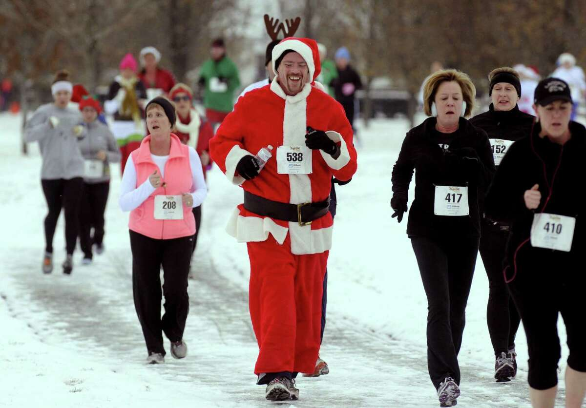 Ken Springer, dressed in a Santa suit, competes in the 2012 Jingle Bell Run/Walk to benefit the Arthritis Foundation of Northeastern New York at the Crossings in a Colonie, NY Thursday Dec. 1, 2012. (Michael P. Farrell/Times Union)